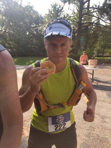 Joe enjoys a donut at mile 22