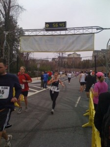Mary Catherine crossing the line at the Chattahoochee 10K with a new PR - the result of a great training program.