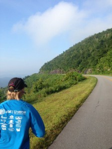 Mary Catherine running a long hill on the Blue Ridge Parkway near Fryingpan Mountain.
