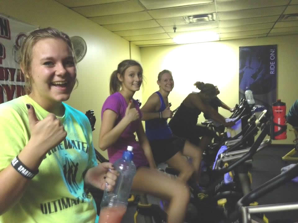 Daughters Alex and Tori with Mary Catherine enjoying a turkey buster indoor cycling class at the gym.