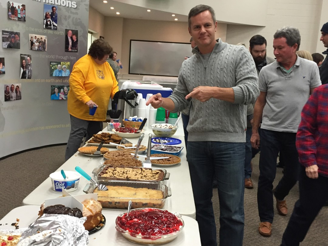 Joe points our the desserts at the RHBC Thanksgiving dinner 2015
