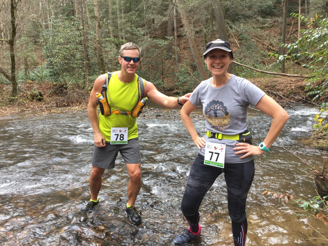 Joe and Mary Catherine crossing Smith Creek during the 2015 Helen Holiday Trail Half-Marathon