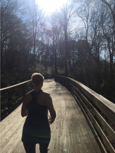 Mary Catherine runs along the boardwalk on the Morrow City Pathway