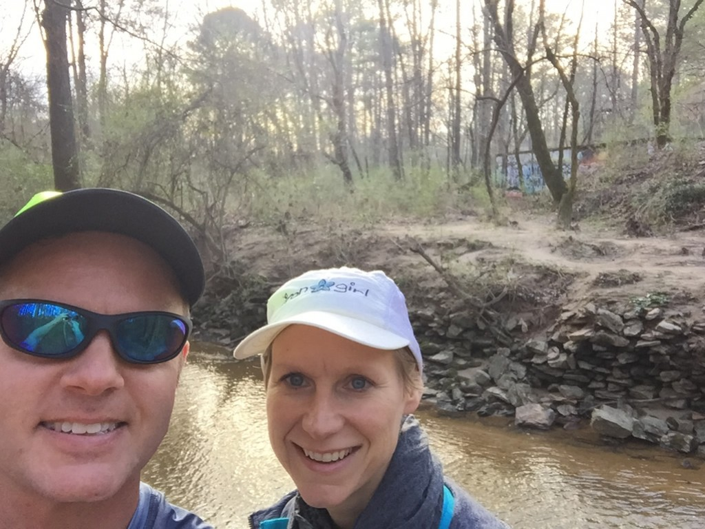 Joe and Mary Catherine pause for a picture along Burnt Fork Creek, with the old Decatur water works ruins in the background