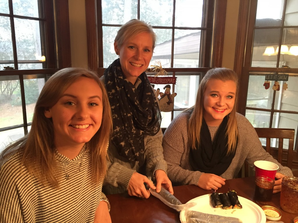 Mary Catherine prepares to enjoy Nori Rolls with our daughters Tori (left) and Alex (right)